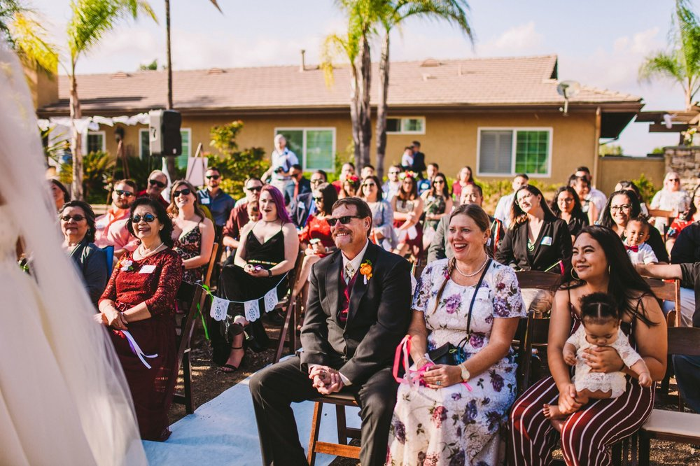Guests Laughing During Wedding Ceremony - Documentary Wedding Photography Temecula