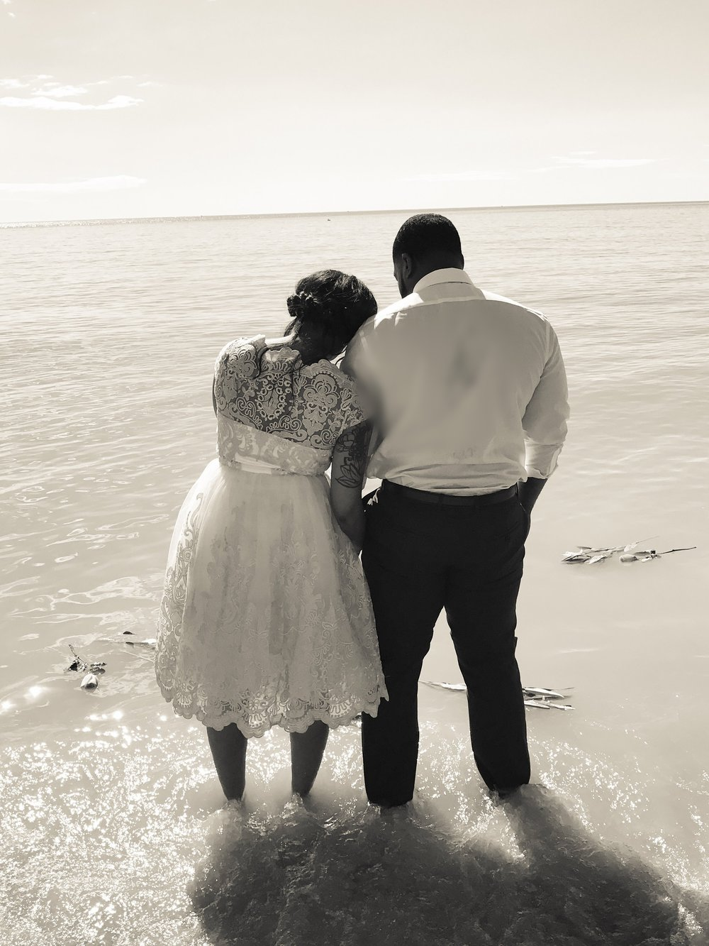 Our wedding day , we put white lilies and pink roses in the ocean for our baby girl.