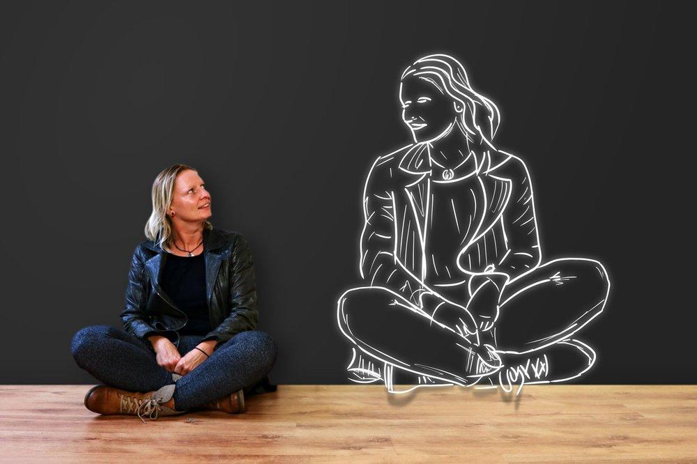 Woman looking at drawing of self.jpeg