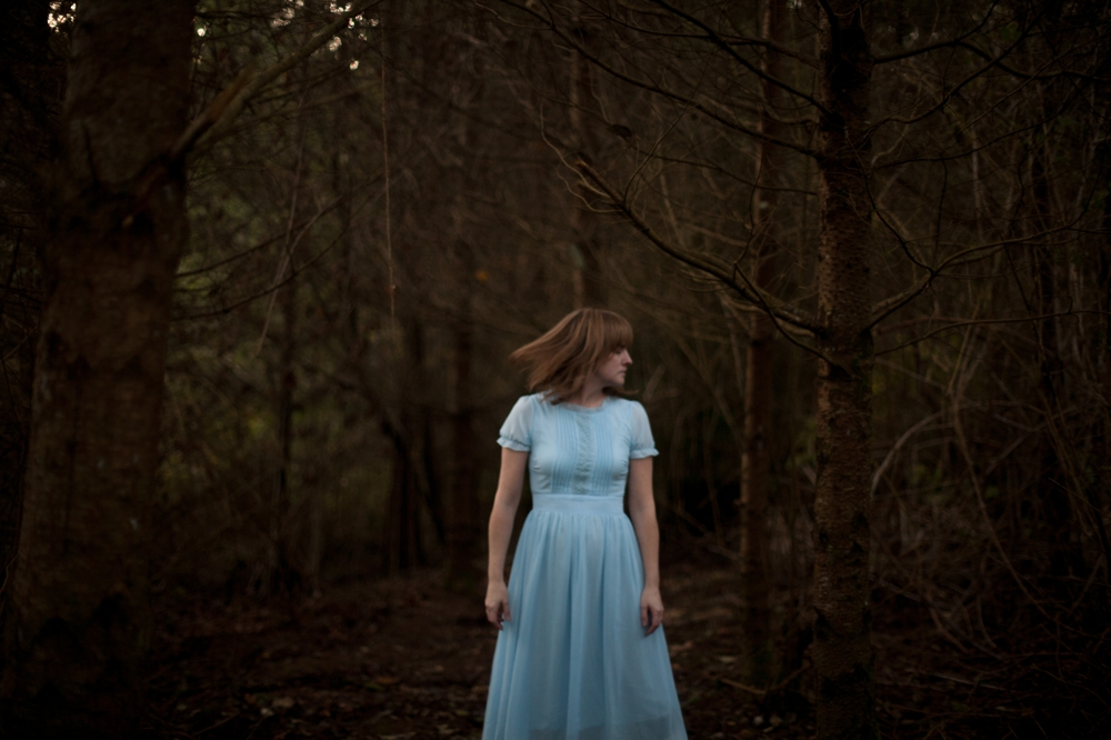 blue dress dark trees self portrait