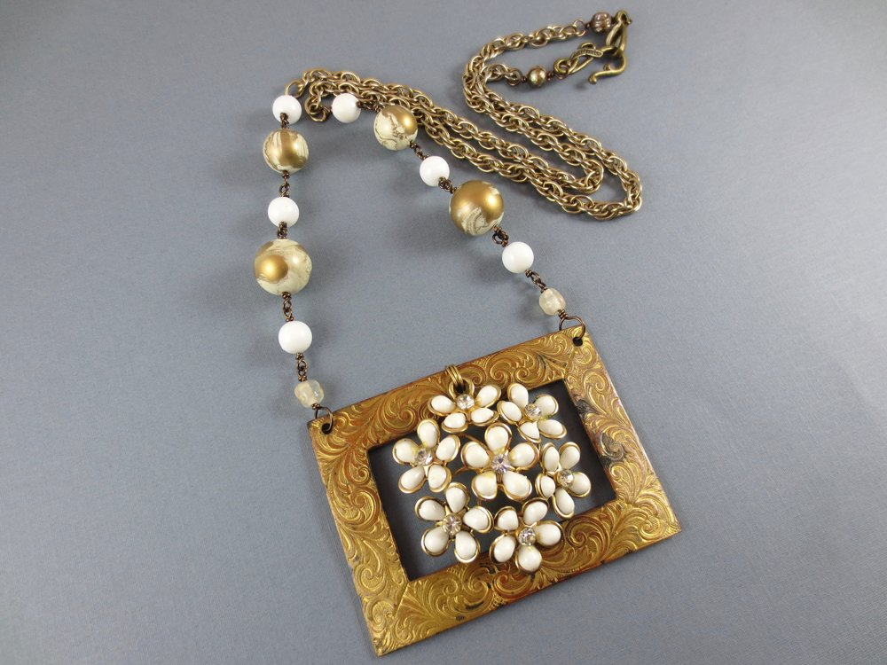 This was made with a variety of vintage components from a few different eras, blended together to make a one of a kind necklace.