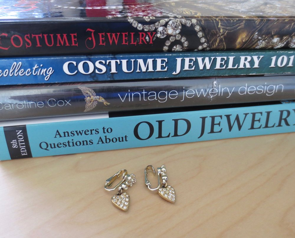 just a few of my books on costume jewelry… and a sweet pair of Sarah Coventry heart earrings 💙