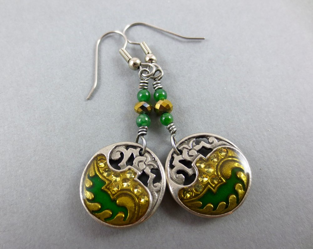 vintage button earrings- silver tone metal inlayed with a wave of sparkly gold and green