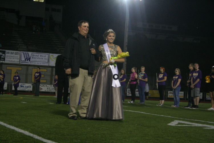 Senior Mackenzie Johnson was escorted by her father.
