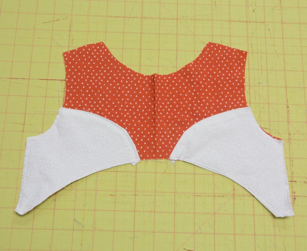 Follow the directions in the pattern to finish the dress. Add a button nose and eyes upon completion!  Get creative and use the face pieces as the base for another animal.  In addition, the Bristol sleeves could be omitted and the construction could be competed with the burrito roll method for a sleeveless version.