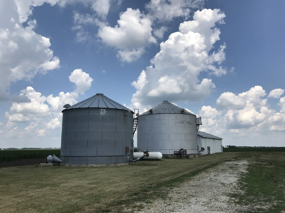 The grain bin and shed located on the south 80-acre tract of the Hunter Trust farm .