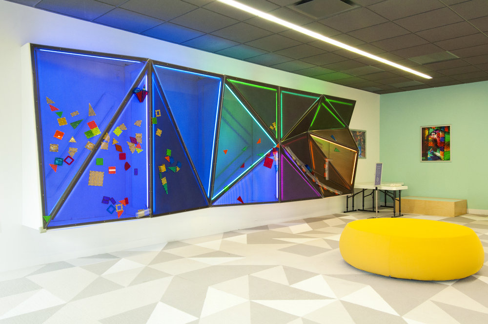 Genius Gems features of one-of-a-kind magnetic light wall that is 20 feet long and 6 feet high.