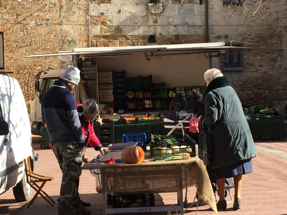 Negotiations on San Gimignano's market day.JPG