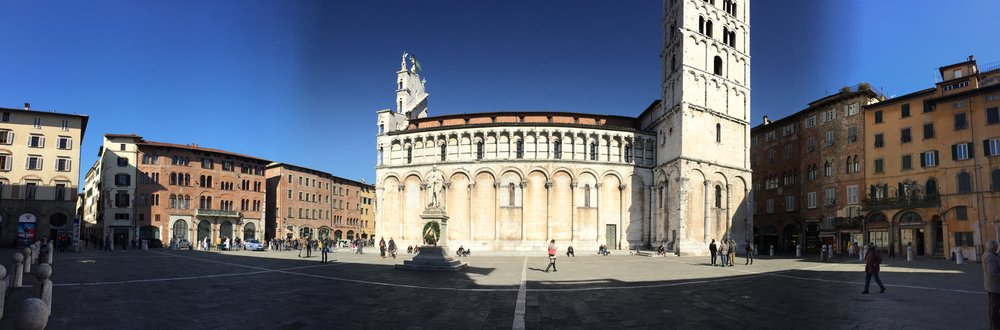 The Piazza and Church of San Michele, shot in pano mode. (It doesn't really bulge like that.)