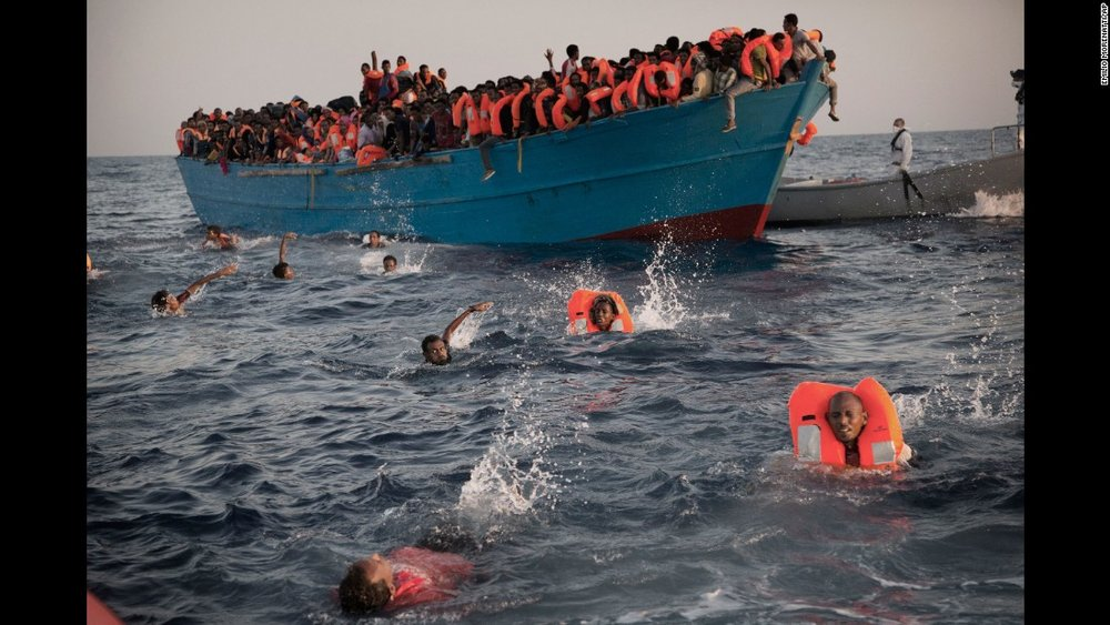 Refugees fleeing war-ravaged countries in the Middle East swim ashore in America demanding immediate employment at Libtard-run coffeehouses.
