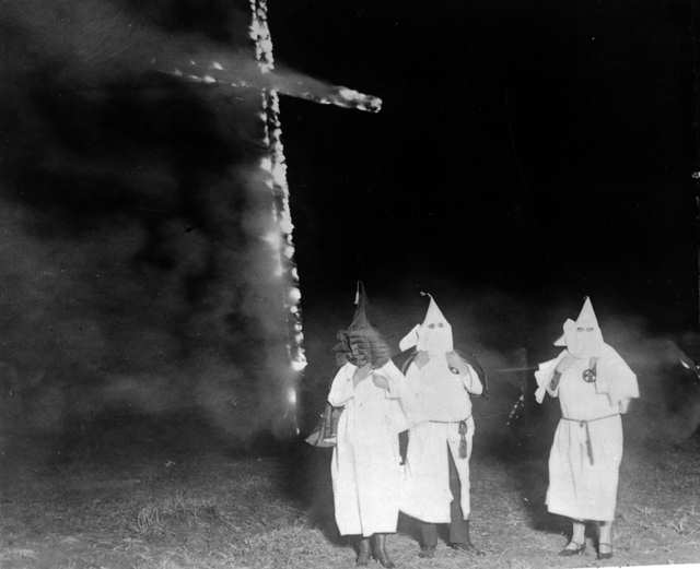 "Presidential advisor Steve Bannon (3rd from left) made it just in time to light a cross on fire. ""That's the real important part anyway."" Bannon said."