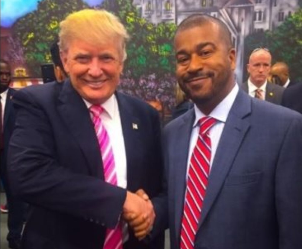 Trump and black person moments after the president remembered his name in a conversation.