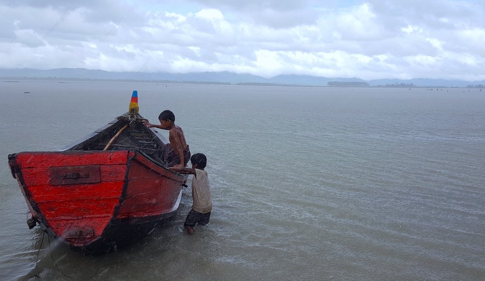 Many Rohingya refugees use boats like these to cross the Naf River. They pay smugglers a fee of about £40 per person in order to fare the dangerous journey from Myanmar to Bangladesh. These smugglers, however, frequently overload boats in the hopes of earning a larger profit. Hundreds have drowned as a product of such boats capsizing. Other Rohingya cannot even attempt the perilous trip to Bangladesh, as they cannot afford to pay the smugglers.