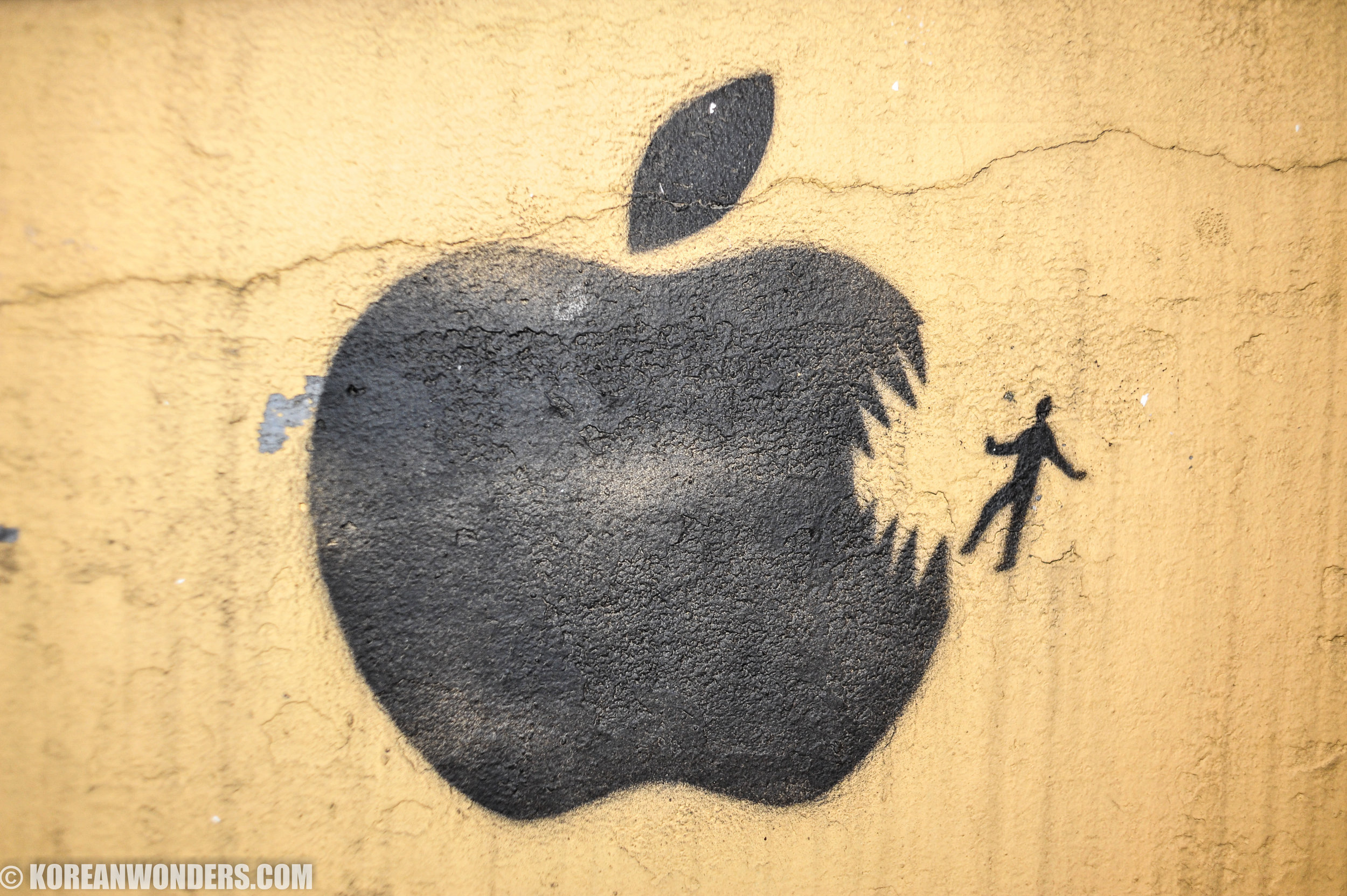Apple eating man graffiti