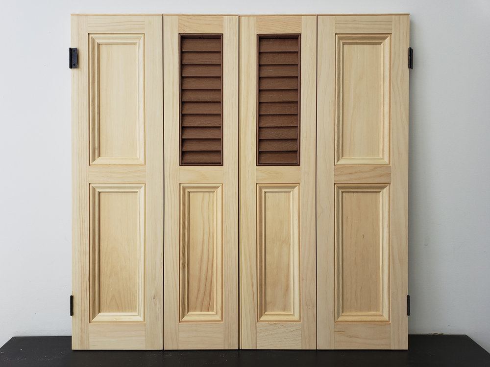 Traditional Eastern White Pine Pocket Shutters with Mahogany Louver Assemblies.