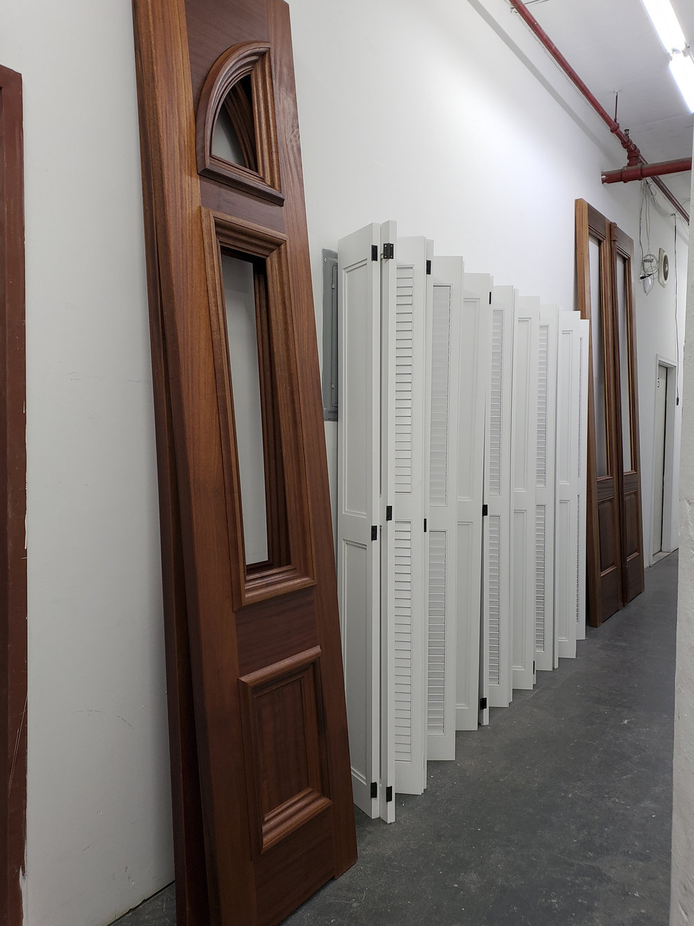 ENTRY DOORS AND LARGE POCKET SHUTTERS