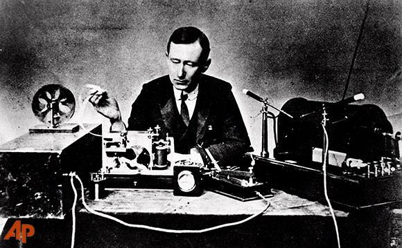 Photo: Guglielmo Marconi reads signals on a tape recorder (left) with a 10-inch spark coil used for ship-to-shore radio tests in this 1901 photo. (Associated Press)