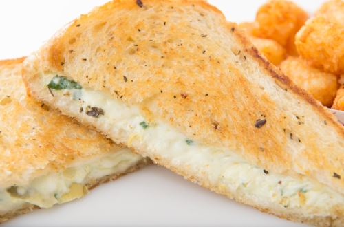 All Choked Up - Artichoke, spinach and parmesan blended with cream cheese, topped with provolone cheese on basil buttered grilled sourdough.