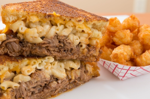 Royale  - BBQ pulled pork topped with creamy mac & cheese & cheddar cheese on basil buttered grilled texas toast.