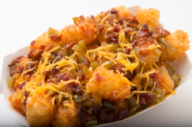 Loaded Tots  - Famous tots topped with cheddar cheese, pickled jalapeno, bacon and hot sauce.