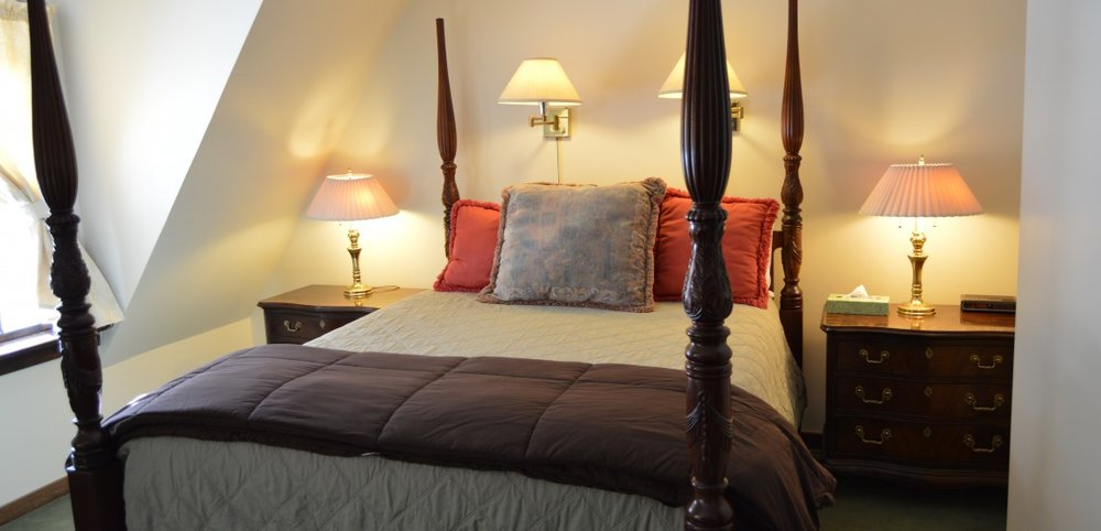 Room Four - Room 4 is located on the second floor and has a full private bath, flat screen TV, and antique furnishings. The comfortable queen size four poster bed is an inviting oasis in this room papered in vintage style wallpaper of soft green hues. WiFi