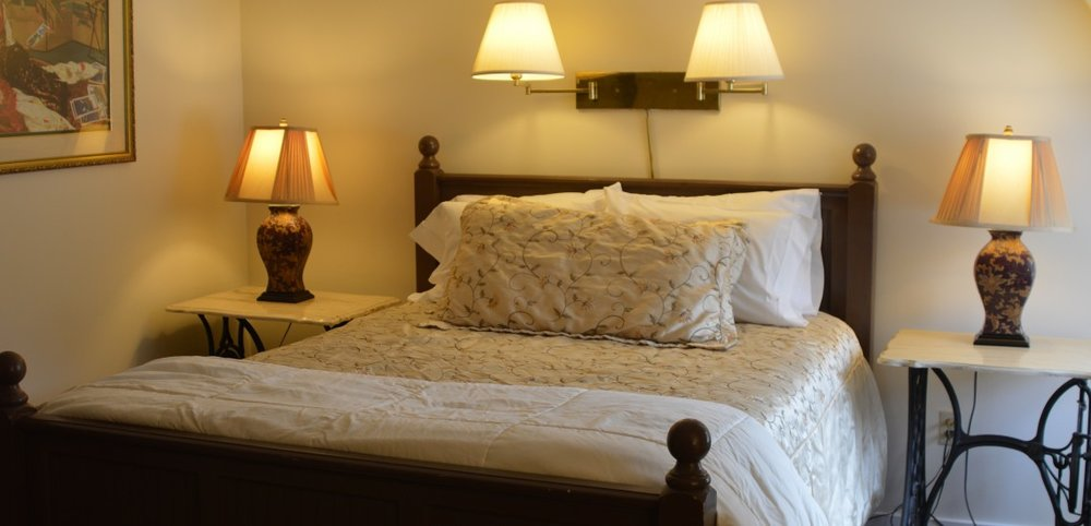Room Five - Room 5 is located on the second floor and has a full private bath, flat screen TV, and a queen size bed. This room is painted in warm neutral tones. Evening sunsets illuminate the space and make for a relaxing stay. WiFi
