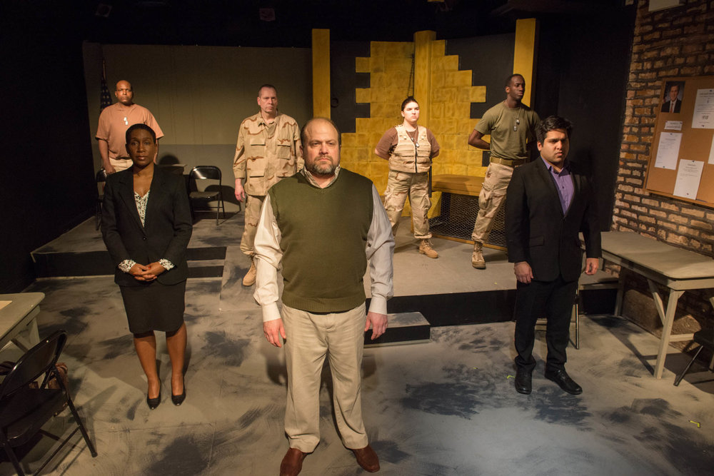 "Front row (L to R) Shariba Rivers as Dr. O'Brien, Steve Silver as Ayyub, Sunny Anam as Abdul Walli; Back row (L to R) Robert Hardaway as Lt. Milo, Tony St. Clair as Col. Lewis, Hannah Tarr as Sgt. Lindsey and David Goodloe as Pvt. Michaels in ""Skin for Skin"" from The Agency Theatre Collective. Photo by Bill Richert."