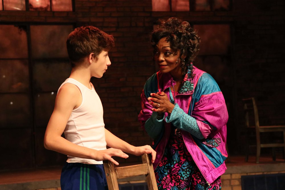 "Lincoln Seymour as ""Billy Elliot"" and Shanésia Davis as ""Mrs. Wilkinson"" in Porchlight Music Theatre's ""Billy Elliot the Musical."" Photo by Austin Packard"