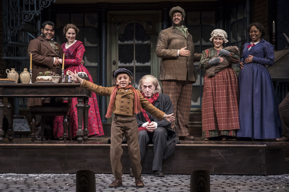 J. Salome Martinez  (Abe),  Ali Burch  (Frida),  Paris Strickland  (Tiny Tim),  Larry Yando  (Ebenezer Scrooge),  Jonah D. Winston ,  Sadieh   Rifai  and  Penelope   Walker  (Mrs.Crumb) in the 40th annual production of  A Christmas Carol , directed by Henry Wishcamper at Goodman Theatre.