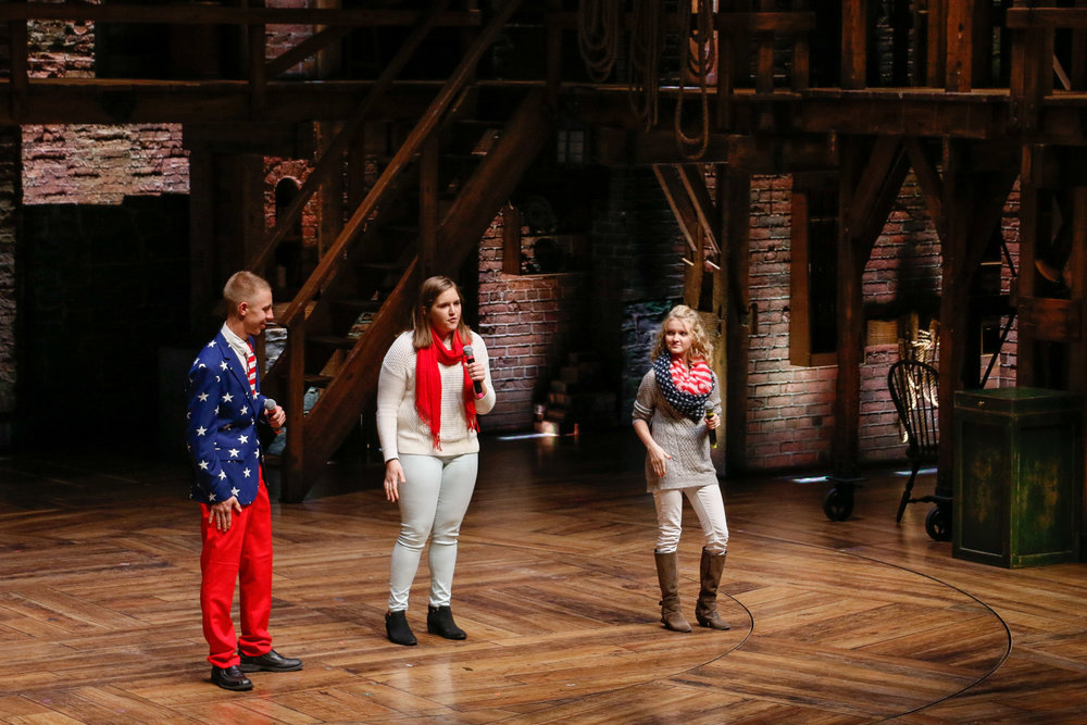 Grace Kindig, Chyenne Deno and Austin Berrenda from South Newton High School perform at CIBC Theatre in part of The Hamilton Project with Chicago Public Schools. Photo by Mary Crylen.