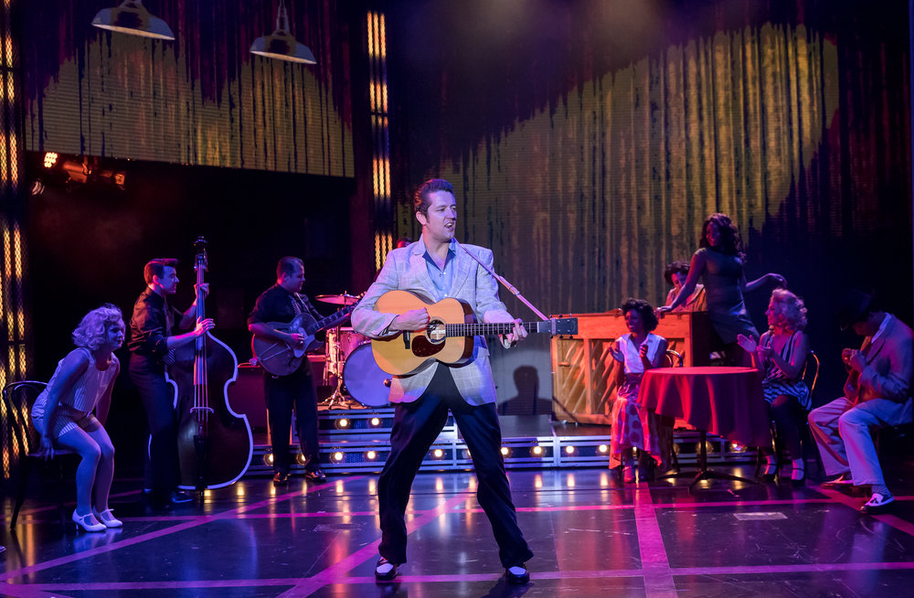 Eddie  Clendening  (Elvis)  and  the  Chicago  company  of  HEARTBREAK  HOTEL  at  the  Broadway  Playhouse  at  Water  Tower  Place