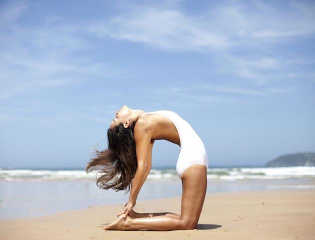 woman_doing_yoga_on_beach_-_166844753__medium_4x3.jpg