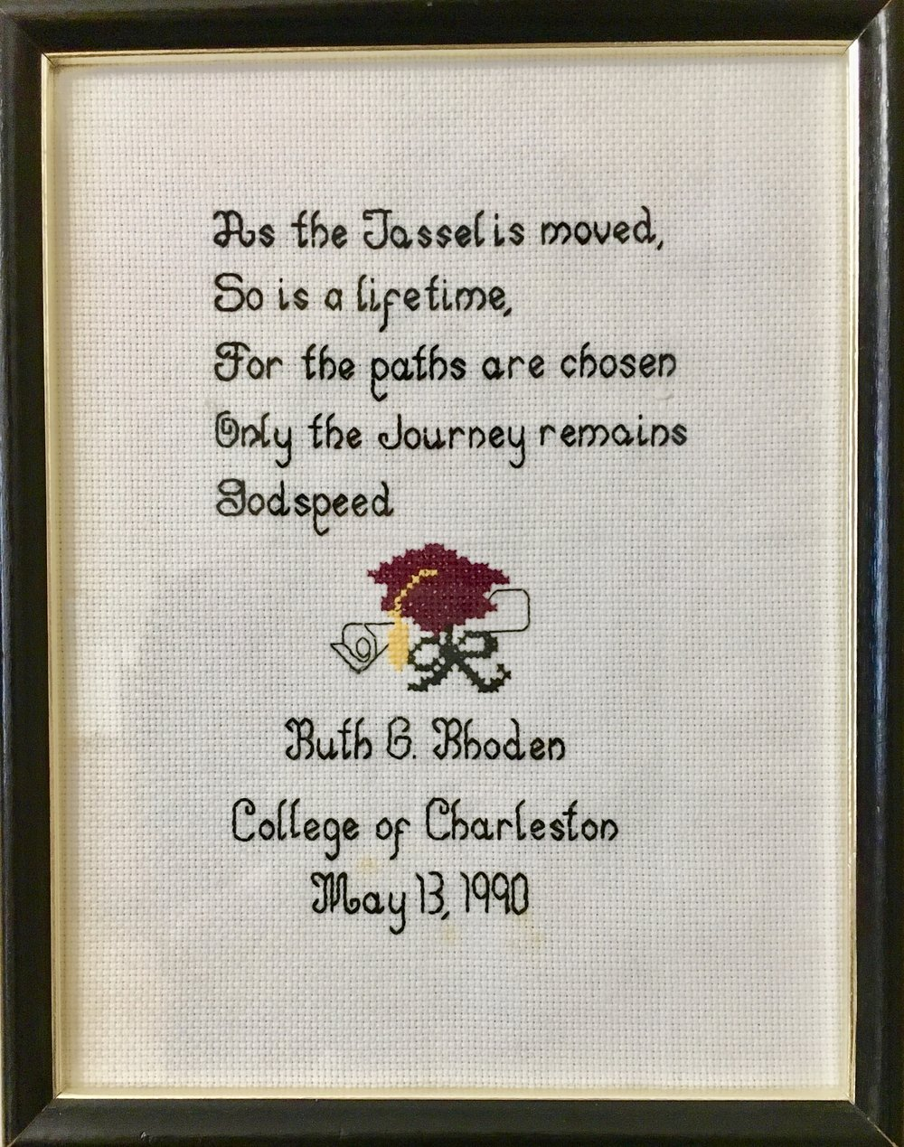 A cross-stitch that hangs in the home of Helena Bradford.