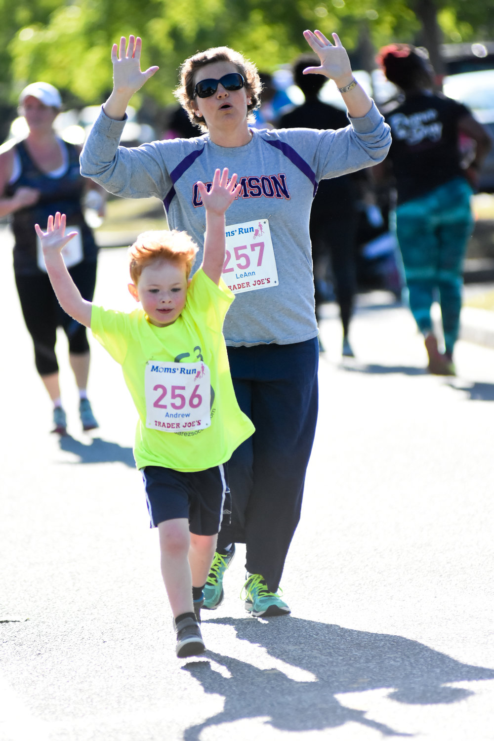 A participant and child in the 2016 Moms' Run 5K and Family Fun Day on Daniel Island.