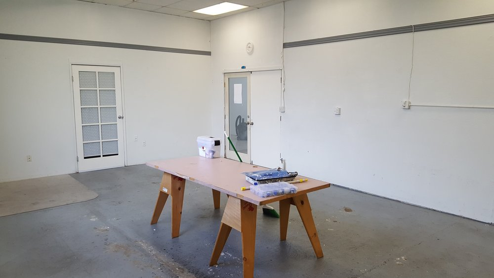 View back towards the main entry doors. Multi-pane door to the left leads into the smaller studio space I'm renting out