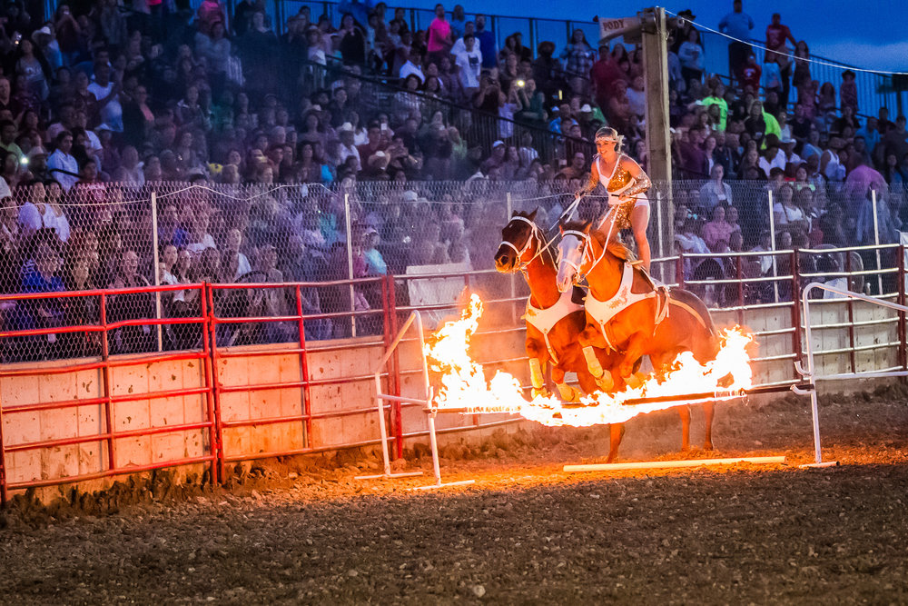 Shanae jumping over fire with her team, Casino and Prince!