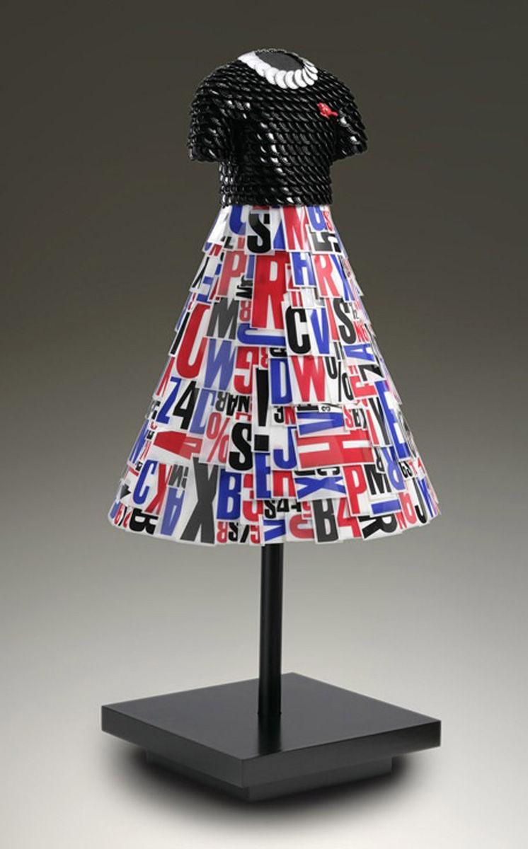Kaye | Black bottle cap bodice with resird bird pin, marquee letter skirt.jpg