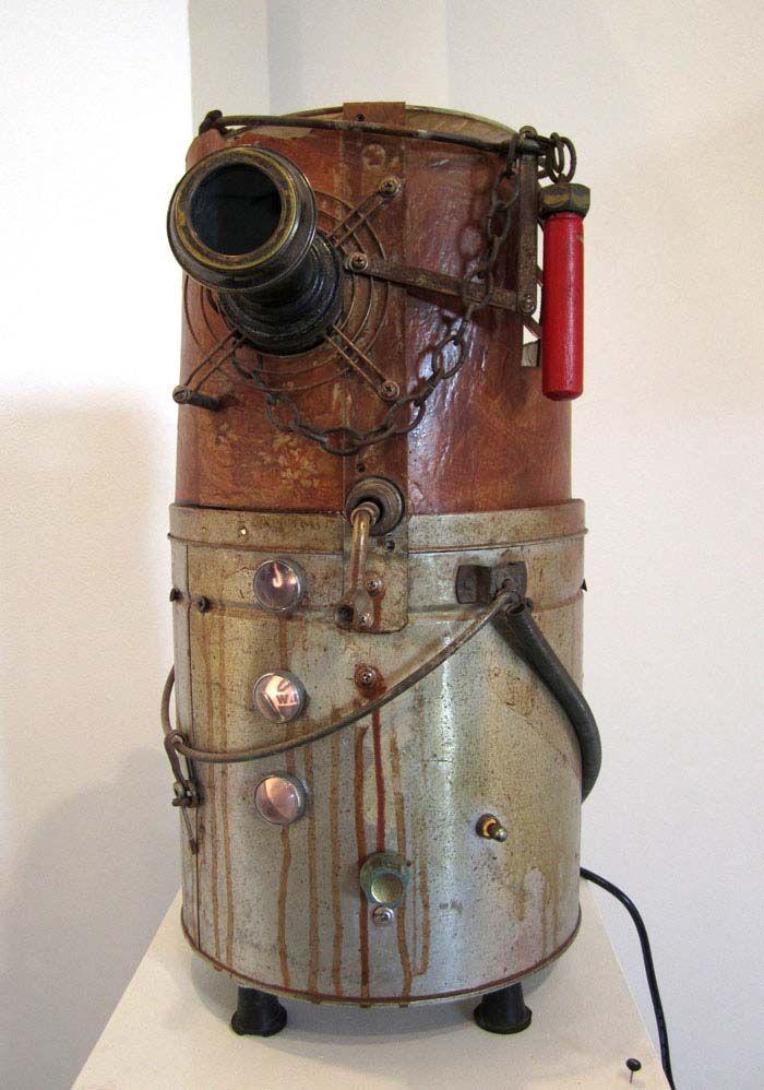 Zoetrope | Bait bucket, phonograph motor, hamster wheel, sanding belt, other repurposed objects.jpg