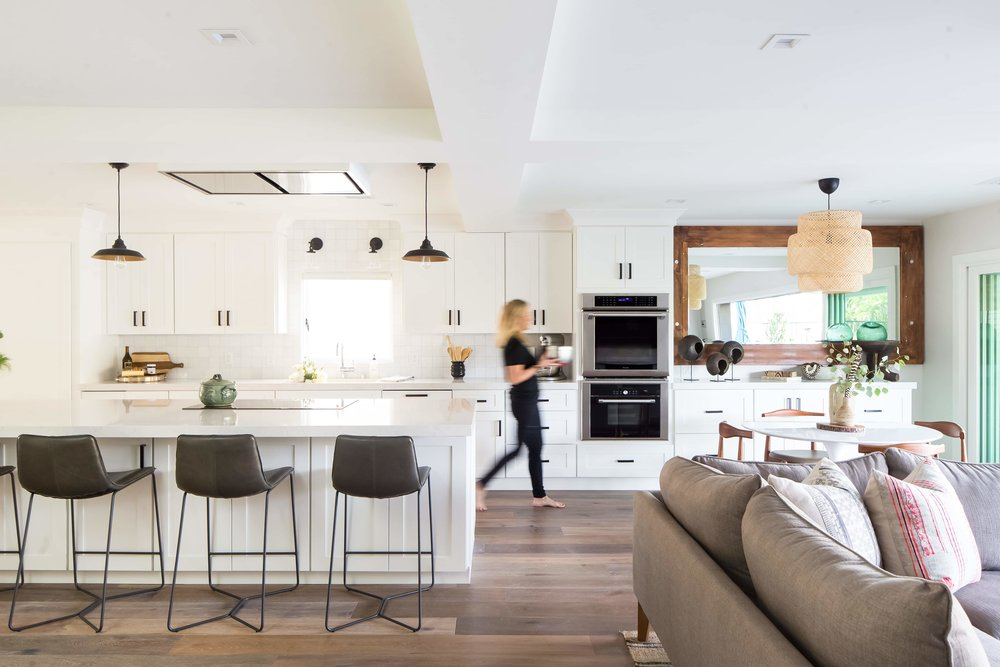 WOMAN BLURRED WALKING TO LIVING ROOM