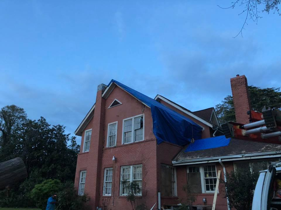 Storm Damage: A tree had fallen onto this home's roof during a severe storm.