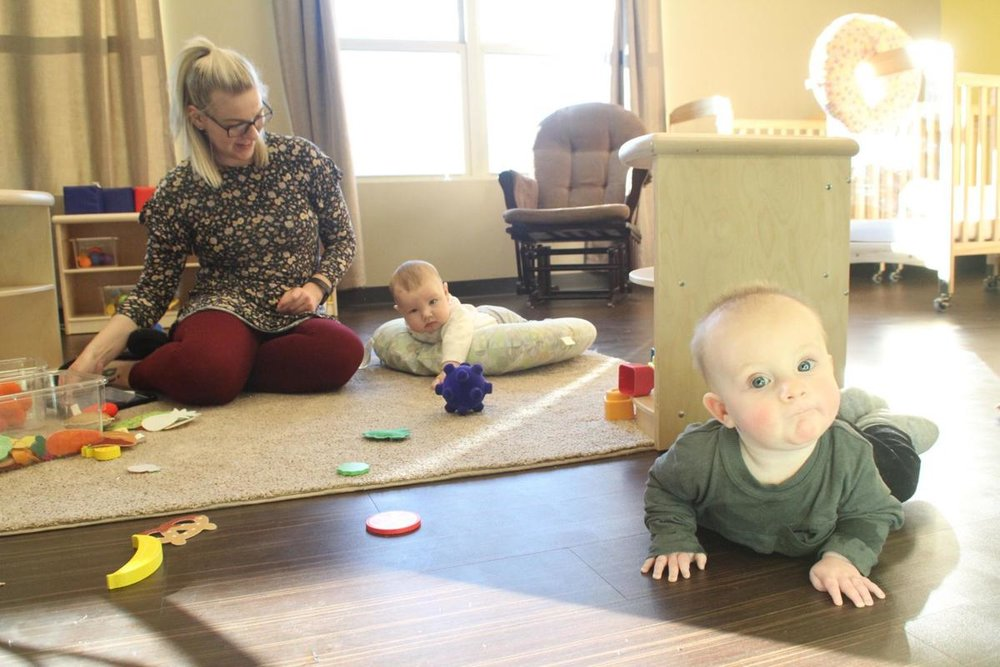 Big Apple Early Learning Academy is now open for new students, and already there are a group of infants who are exploring the bran-new building, under the watchful eyes of Teacher Gabby Lee.