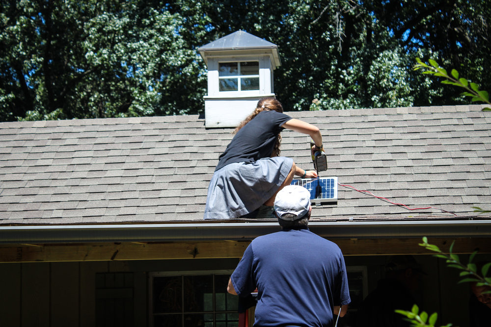 Installing the solar panel. Photo by Cathy Barber.