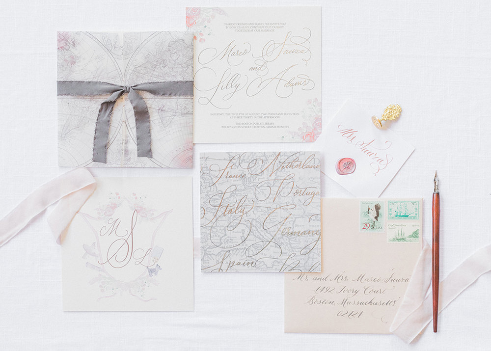 wedding invitation design with a travel theme featuring antique maps