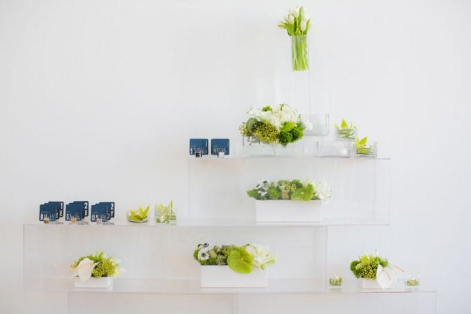 19 Sweetchic green modern fresh tablescape hinojosa photography. loft. modern escort card arrangement. laser cut escort cards. acrylic pedestals
