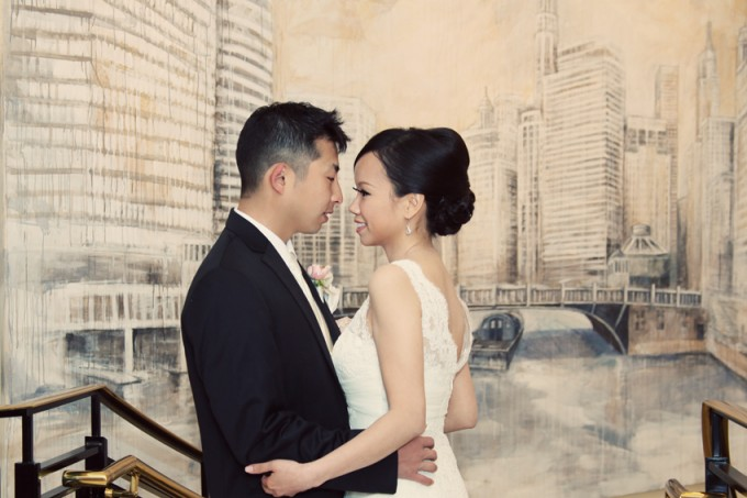 15. Rookery Wedding. Kevin Le Photography. Sweetchic Events. Bride and Groom in front of artwork.