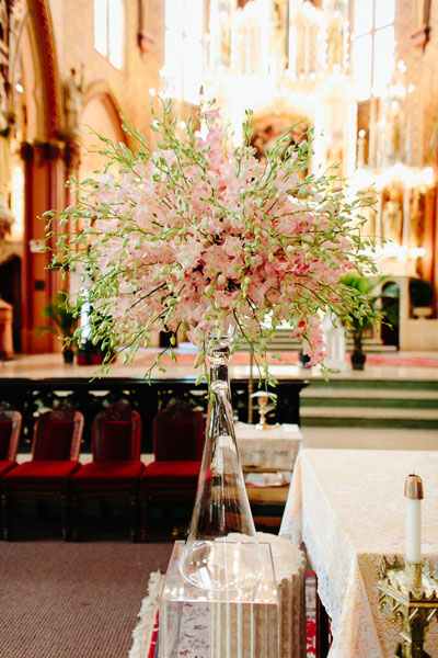 16. Trump Tower Wedding. Pen Carlson Photography. Sweetchic Events. Vale of Enna. Altar Decor. Glass Vase topped with an array of pink and white dendrobium orchid.