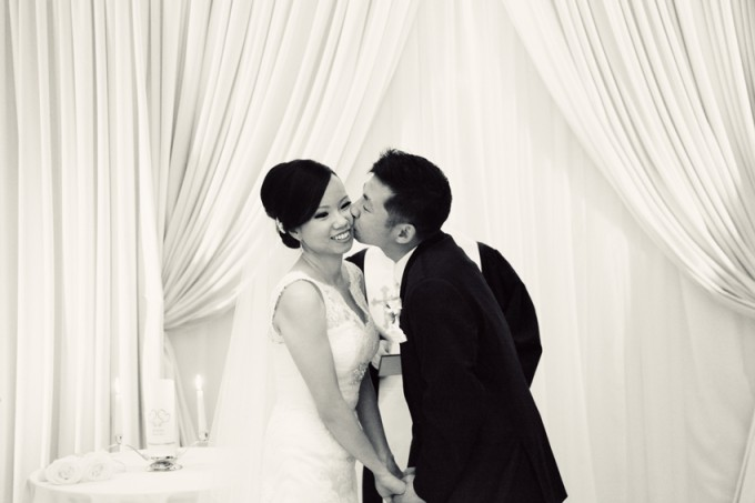 32.  Rookery Wedding. Kevin Le Photography. Sweetchic Events. Ceremony Kiss on Cheek.