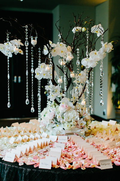 44. Trump. Pen Carlson Photography. Sweetchic Events. Vale of Enna. Manzanita Branch Escort Card Arrangement with Ombre Petals, Hanging Crystals, Pink and White  Orchids.