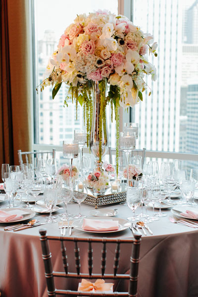 58.  Trump. Pen Carlson Photography. Sweetchic Events. Vale of Enna. Mirrored Vase Centerpiece Hydrangea, Lillies, Orchids, Blush Pink Peonies, Roses, Hanging Amaranthus.