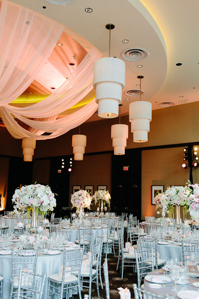 62. Trump Tower Wedding. Pen Carlson Photography. Sweetchic Events. Frost Lighting. Elegant Gray and Blush Pink Wedding Reception. Blush Pink Fabric Ceiling Drapery.